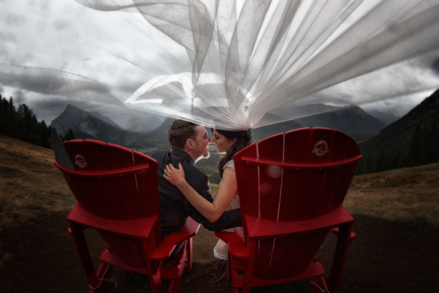 Bride & groom at the Red Chairs in the Banff National Park.