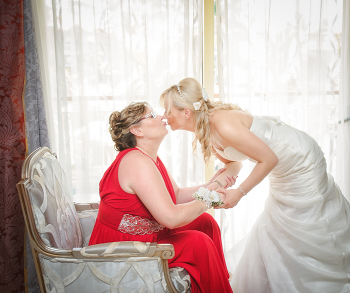 Bride with her mother before wedding.