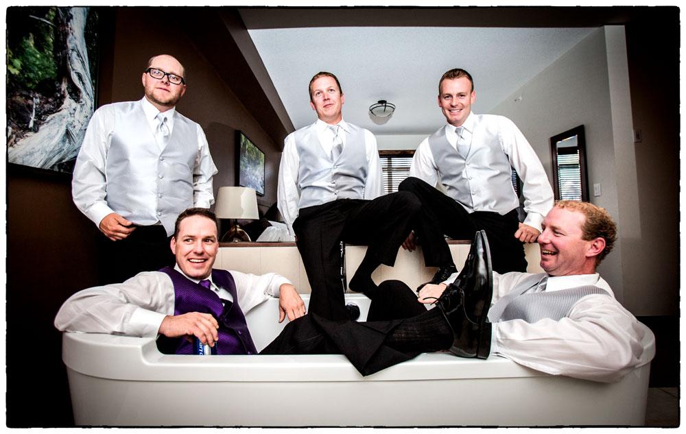Groom and his groomsmen kick back before the wedding.