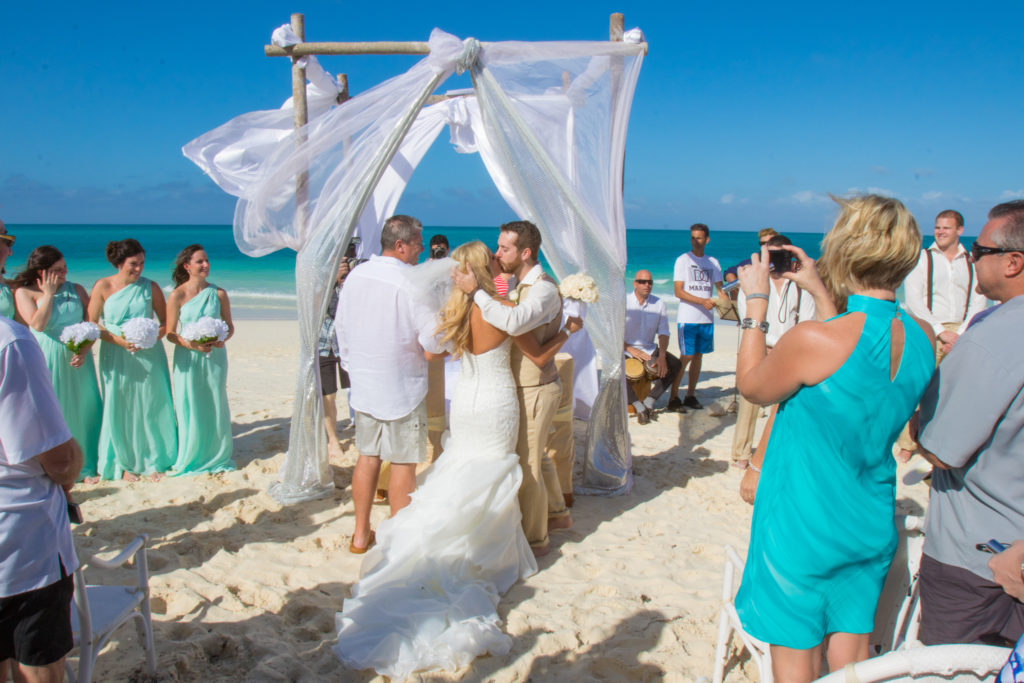 A different angle: The father of the bride hands her off to her new husband in Cuba beach ceremony, Cayo Santa Maria.