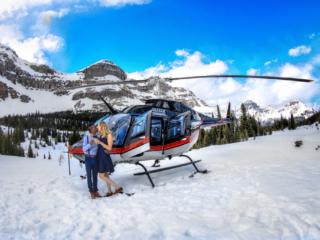 Mountaintop wedding proposal with banff wedding photographers, Burnett Photography and Rockies Heli Canada