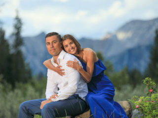 Newly engaged couple in the Quarry Lake fields, Canmore, AB