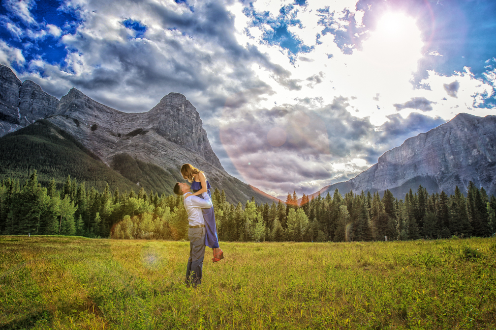 Sun flare from behind Ha Ling. Engagement pictures, Canmore.