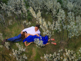 Among the wolf willow. I had to sit on Troy's shoulders for this picture.