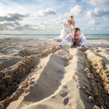 Bride drags groom off to happy ever after.