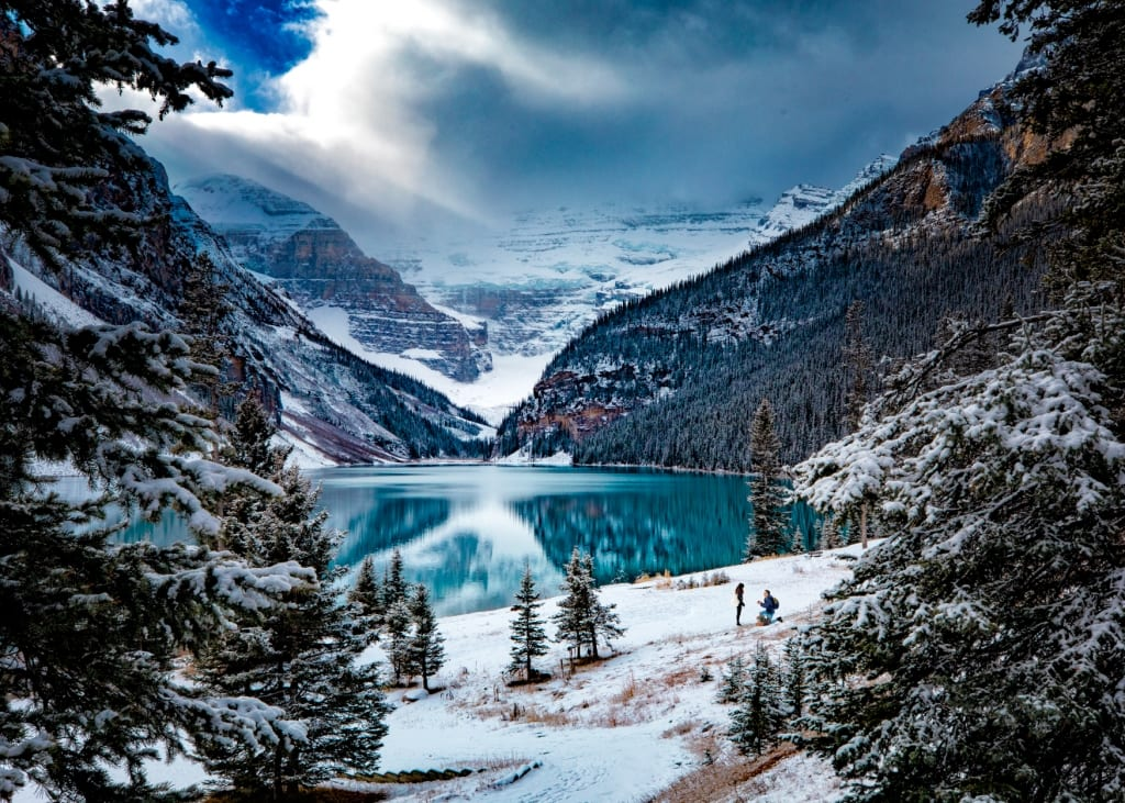 Lake Louise proposal by Banff wedding photographers,Burnett Photography,