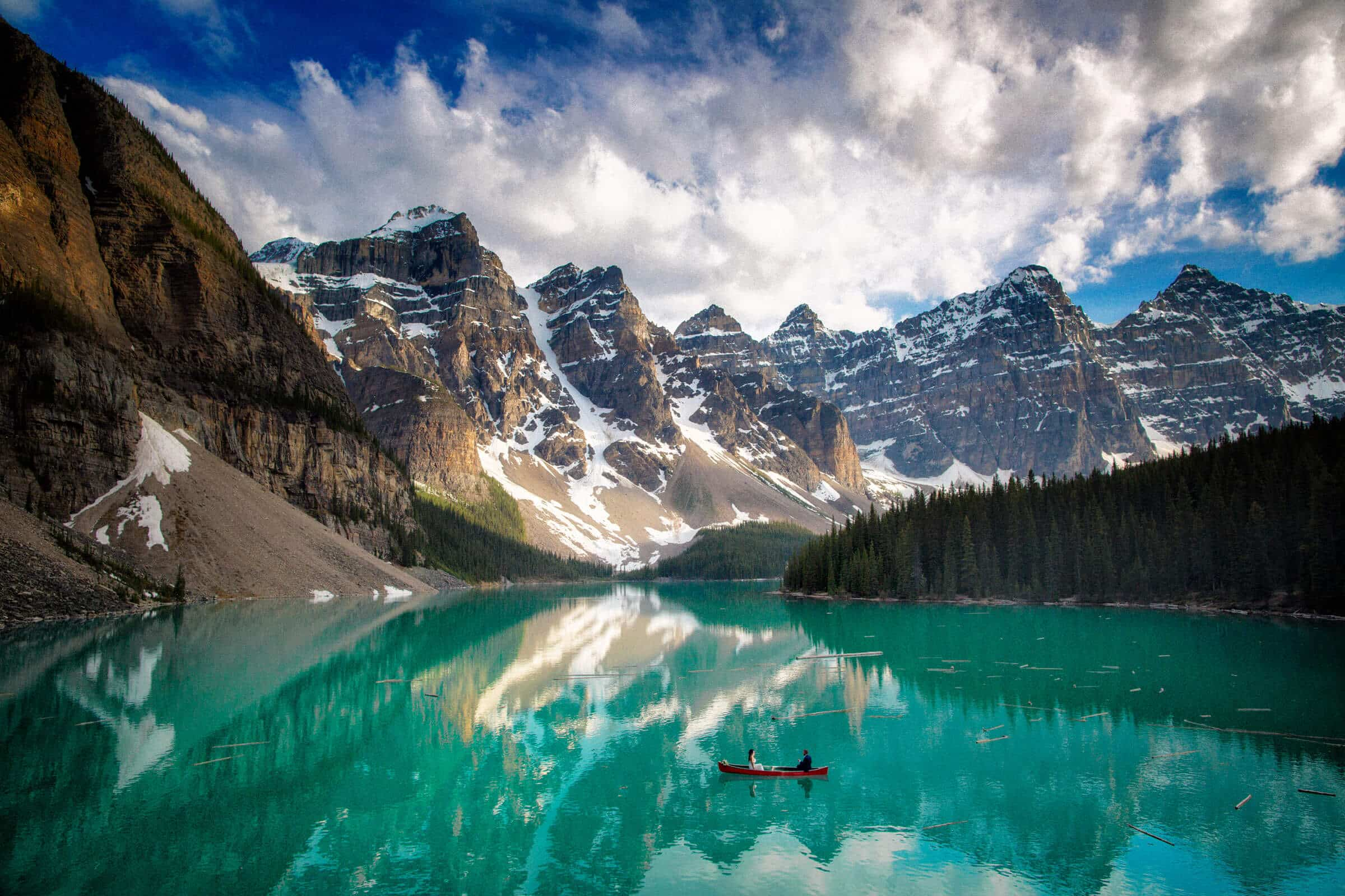 Elopement Moraine Lake. Newly weds enjoy a canoe paddle on beautiful Moraine Lake.