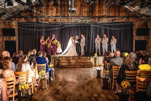 Canmore wedding photographer capture wedding ceremony in Canmore at the Cornerstone Theater..