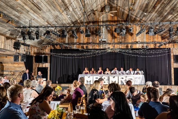 Canmore wedding photographers capture wedding reception in Canmore at the Cornerstone Theater..