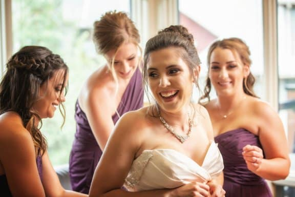 Canmore wedding. Bride getting ready with her bridesmaids.