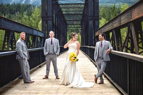 Canmore wedding photographer picture of bride with groom's men wedding photography in Canmore.