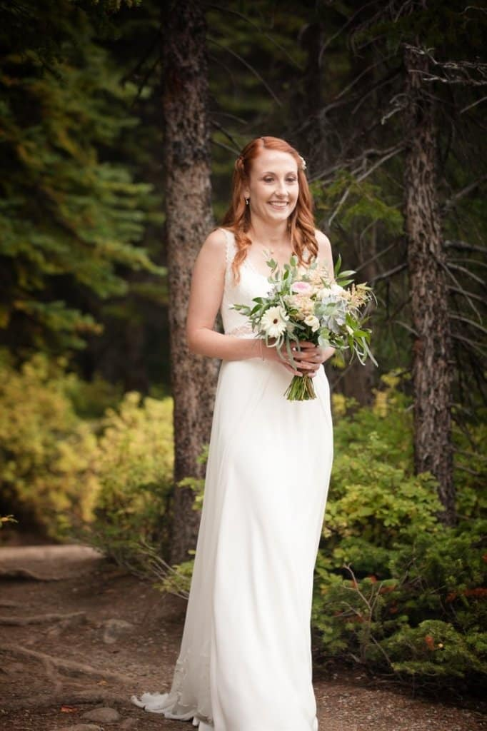 Moraine Lake Elopement Photography. The bride enters through the woods.