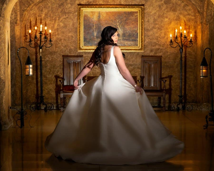 Banff Springs Hotel Wedding. Bride poses in the Mt. Stephan's Hall. By Banff wedding photographers, Burnett Photography.