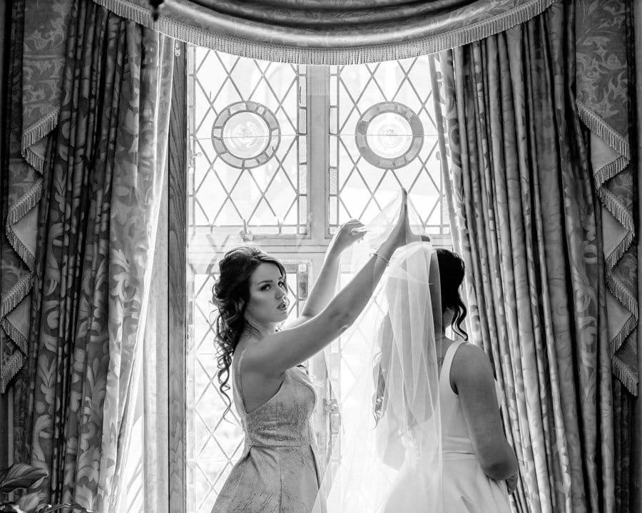 Banff Springs Hotel Wedding.Bride getting ready in the bathroom beside the Mt. Stephan's Hall. by Banff wedding photographers, Burnett Photography.