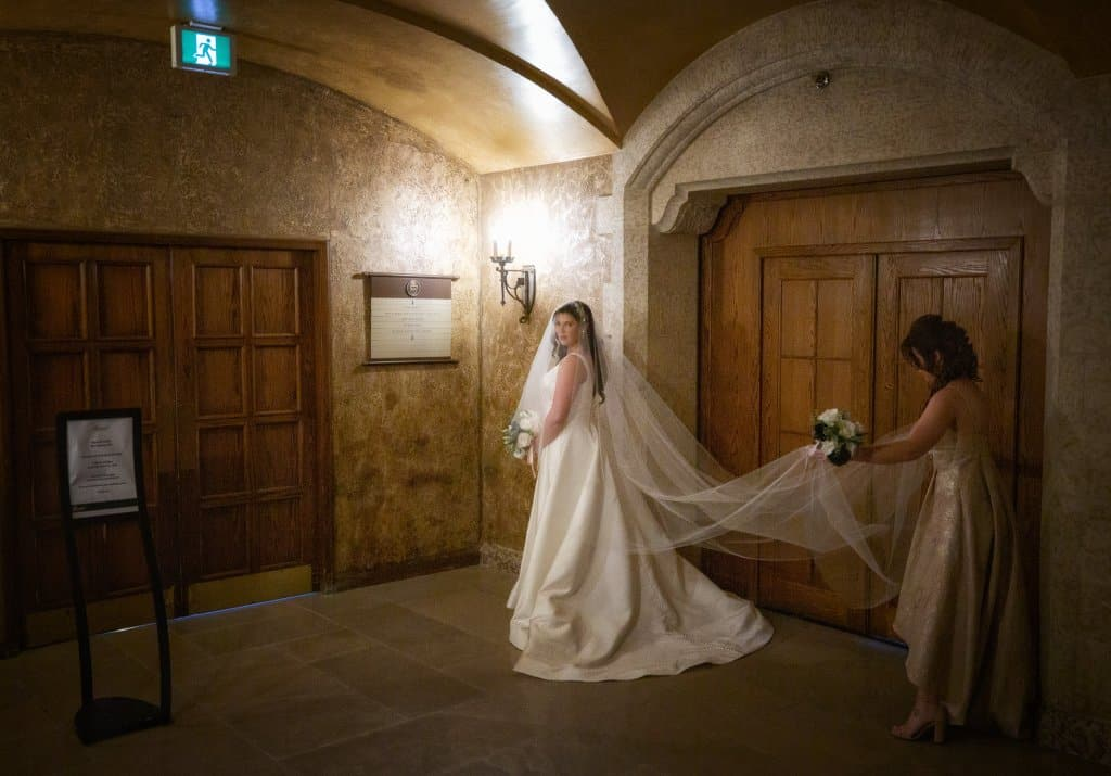 Banff Springs Hotel Wedding. Bride waiting before ceremony in the Mt. Stephan's Hall. by Banff wedding photographers, Burnett Photography.
