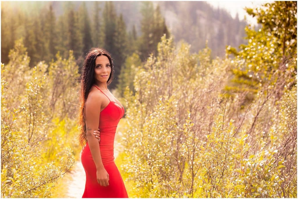 Lady in Red, Engagement session during smoke season in the Banff National Park, by Banff photographers, Burnett Photography.